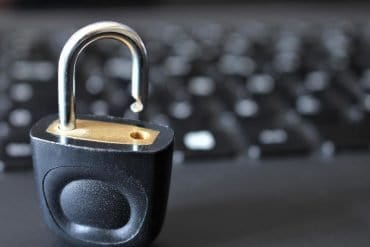 Lock in front of computer showing Quora data breach of 100 million passwords