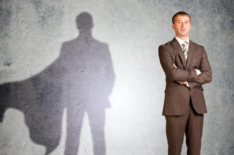 GDPR data protection officer (DPO) with superman shadow looking at camera