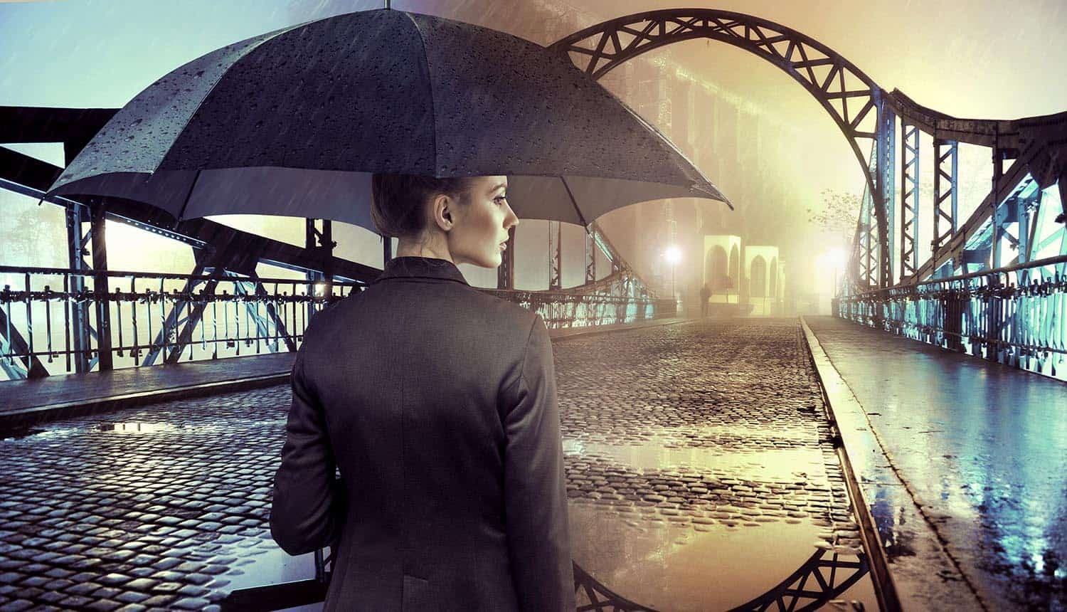 Businesswoman standing in the rain holding umbrella showing that cyber insurance coverage may not be what was expected