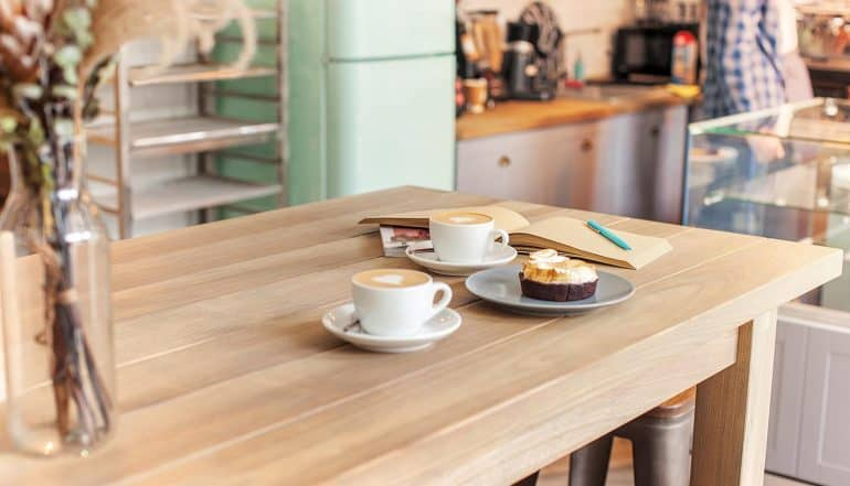 Table setting on the counter for coffee with privacy pros