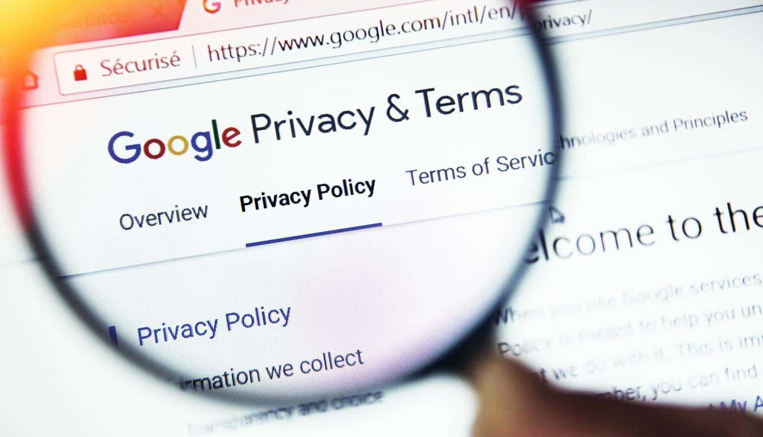 Privacy terms on Google website magnified with magnifying glass showing the cause of GDPR fines