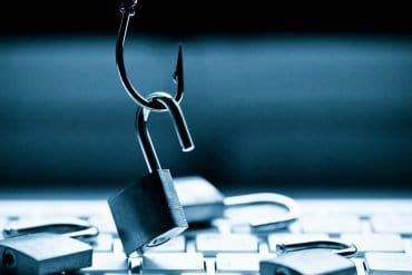 Hook picking up a lock showing phishing scams on computer system