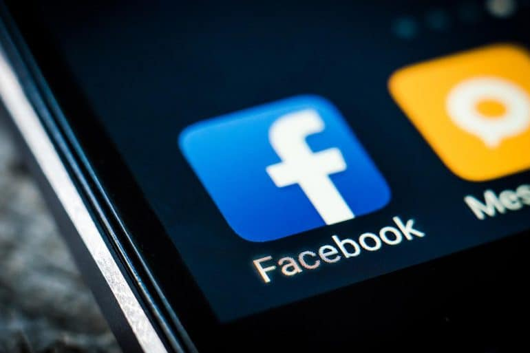 Facebook android app icon on a smartphone screen showing how personal data is shared without user consent