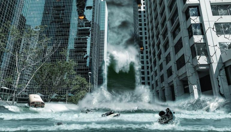Portrayal of a city destroyed by tsunami waves showing need for effective business continuity plan