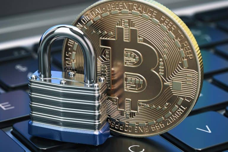 Cryptocurrency bitcoin coin and padlock lock on computer keyboard showing crypto-regulations for virtual currencies