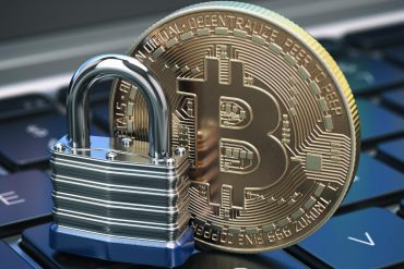 Cryptocurrency bitcoin coin and padlock lock on computer keyboard