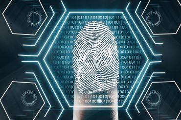 Futuristic fingerprint scanning device collecting biometric data