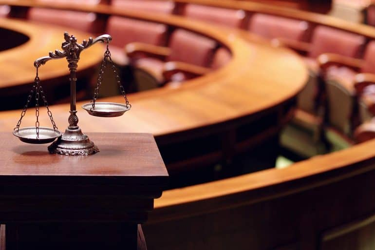 Symbol of law and justice in the empty courtroom showing proposed data privacy act for Washington state
