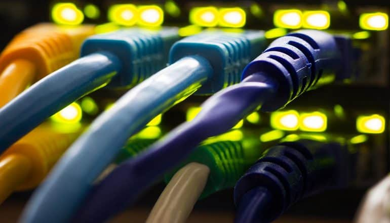 Network cables plugged into a switch hub showing Russia Internet control to unplug
