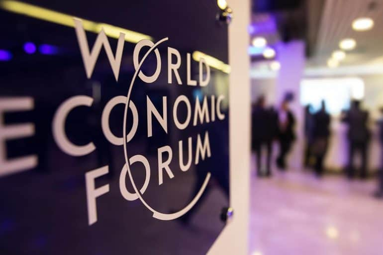 Emblem of the World Economic Forum in Davos showing increased calls for tech regulation and data governance
