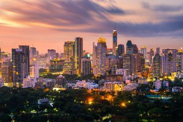 Bangkok city skyline downtown and clouds at sunset showing impact of new Thailand cybersecurity law