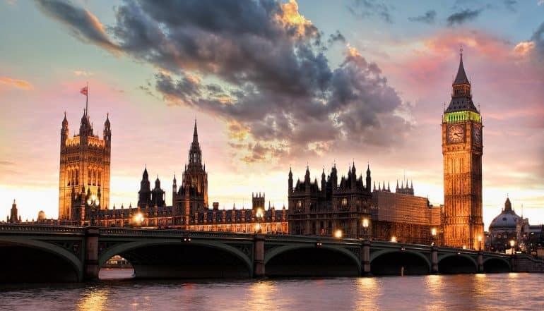 Big Ben against colorful sunset in London showing UK report calling Facebook a digital gangster