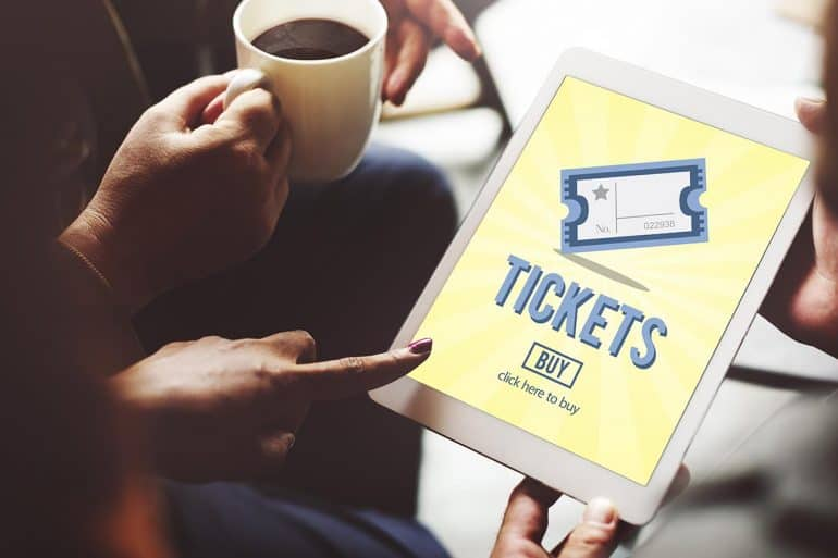 Woman buying tickets using iPad showing the new formjacking threat