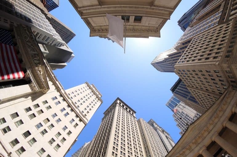 Fisheye view of Wall Street buildings in New York City USA showing need for financial services firms to pay attention to CCPA