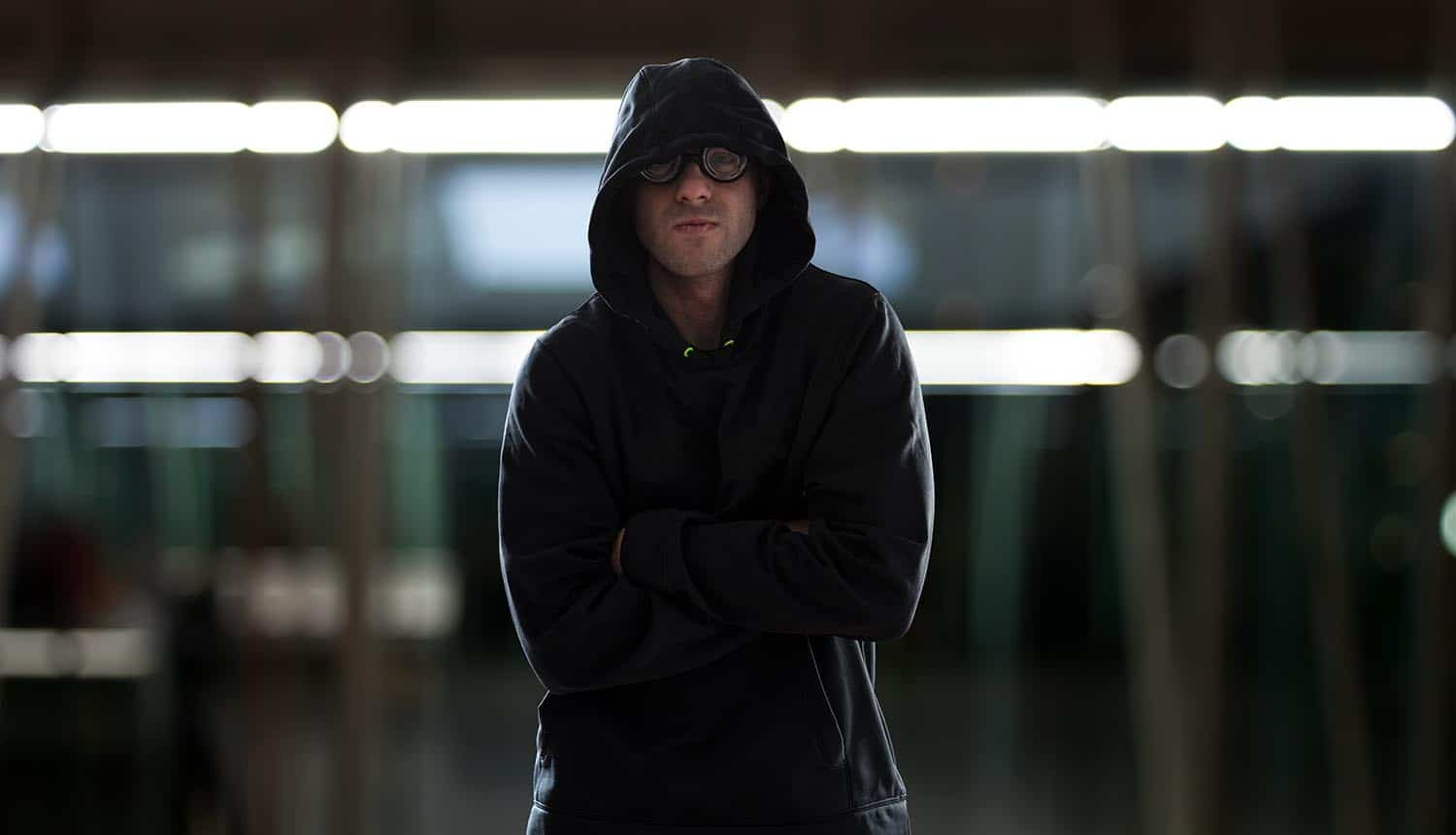 Hacker looking smug and standing with arms crossed showing the need for faster cyber response