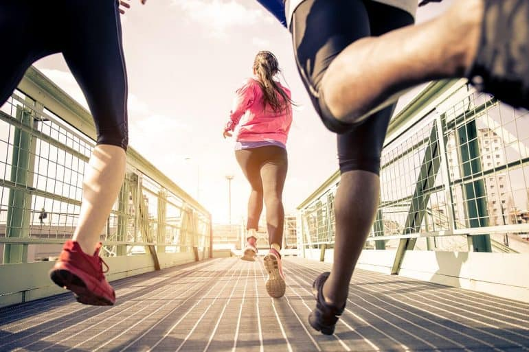 Three runners sprinting outdoors showing the cybersecurity arms race
