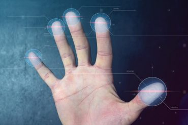 Man passing biometric identification with fingerprint scanner