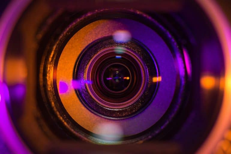 Close up shot of video camera lens showing the privacy threat of cameras and microphones
