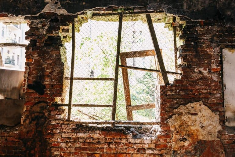 Inside ruined abandoned house building after disaster showing the impact of data breach on disaster survivors