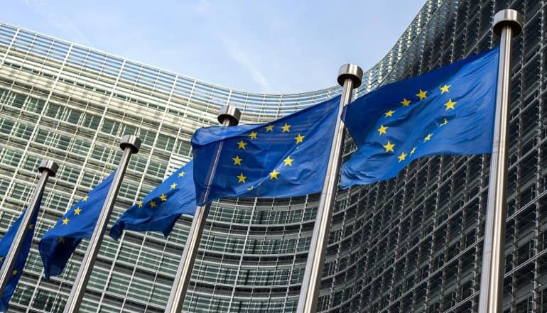 European Union flags in front of European Commission building showing requirement for organizations to appoint a Nominated European Representative under certain conditions in GDPR Article 27
