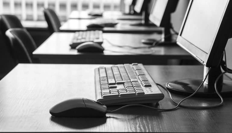 Computers in black and white showing that universities are still very vulnerable to cyber attacks
