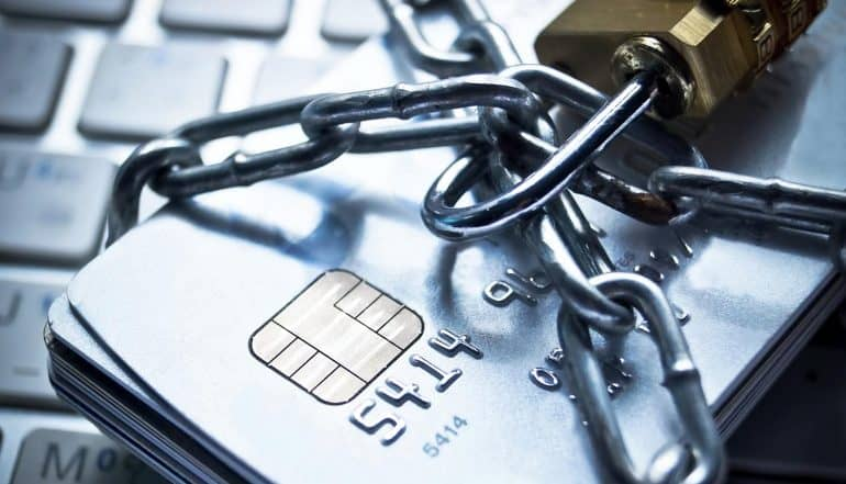Credit card with chain and lock showing the use of AI to fight online payment fraud while making improvements to avoid false positives