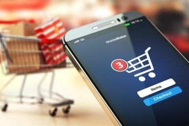 Online shopping using mobile phone showing use of digital payment methods