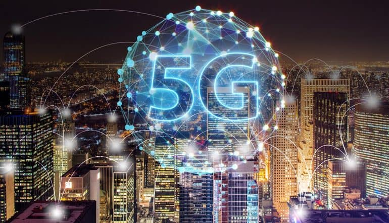 5G connectivity map against city night scene showing growing concerns for IoT security in 5G networks