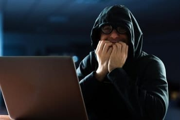 Man in shock with computer showing the unknown cyber threats to company data assets