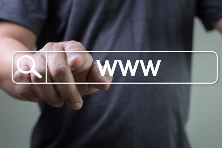 Man pointing at www symbol showing the key things to look for on a website for security