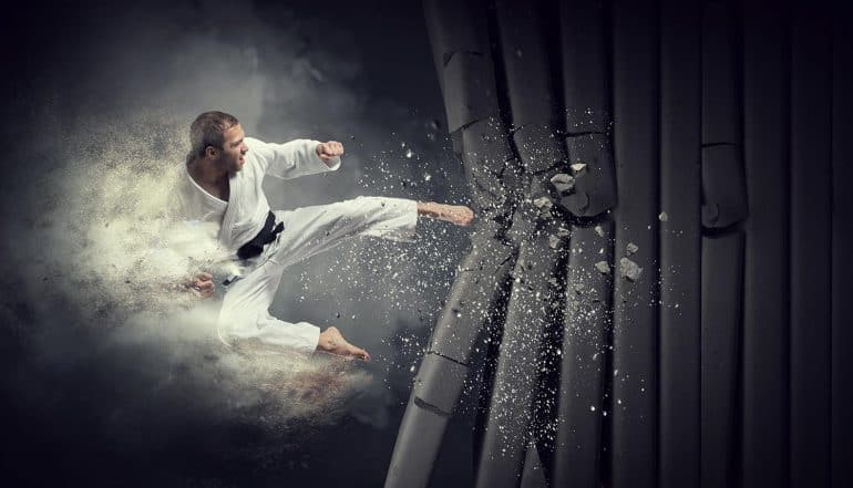 Karate man breaks wall showing Israel's cyber response using missile strike