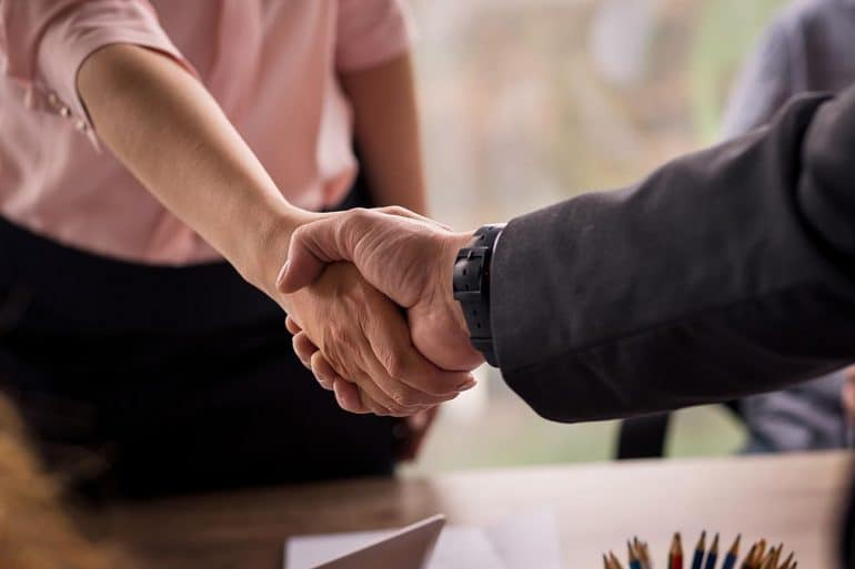 Business handshake showing need for companies to act now to take the complexity out of consumer consent