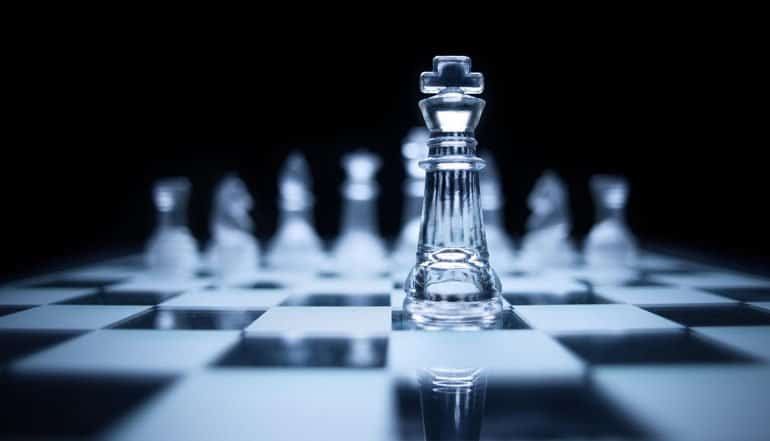 King pawn on chess board showing the potential privacy and security implications of new Federal Data Strategy in U.S.