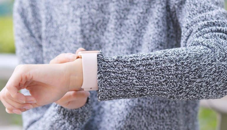 Woman using smart watch showing how identity signals could help to address data privacy concerns of connected devices