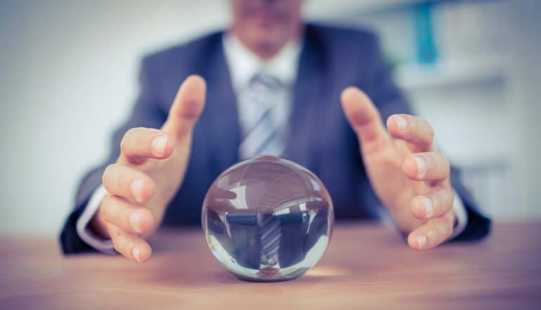 Man forecasting a crystal ball showing the possible data breach settlement that companies could face with the record-setting FTC fine on Equifax