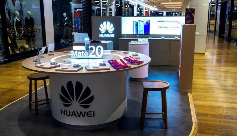 Huawei mobile phone shop showing privacy concerns on Hongmeng OS