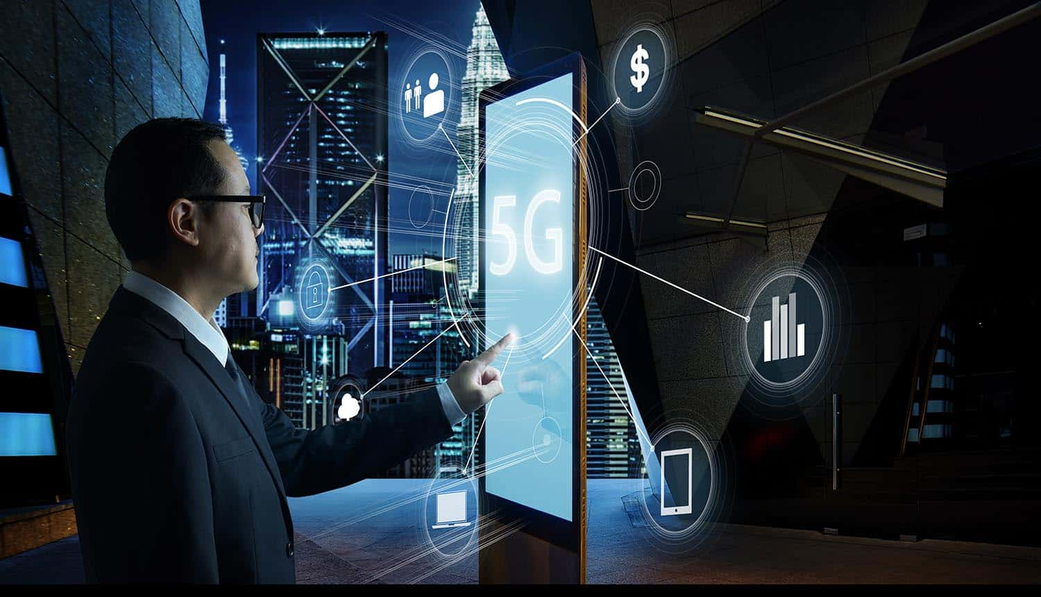Businessman touching internet of things in 5G network showing the push of 5G IoT market towards edge computing
