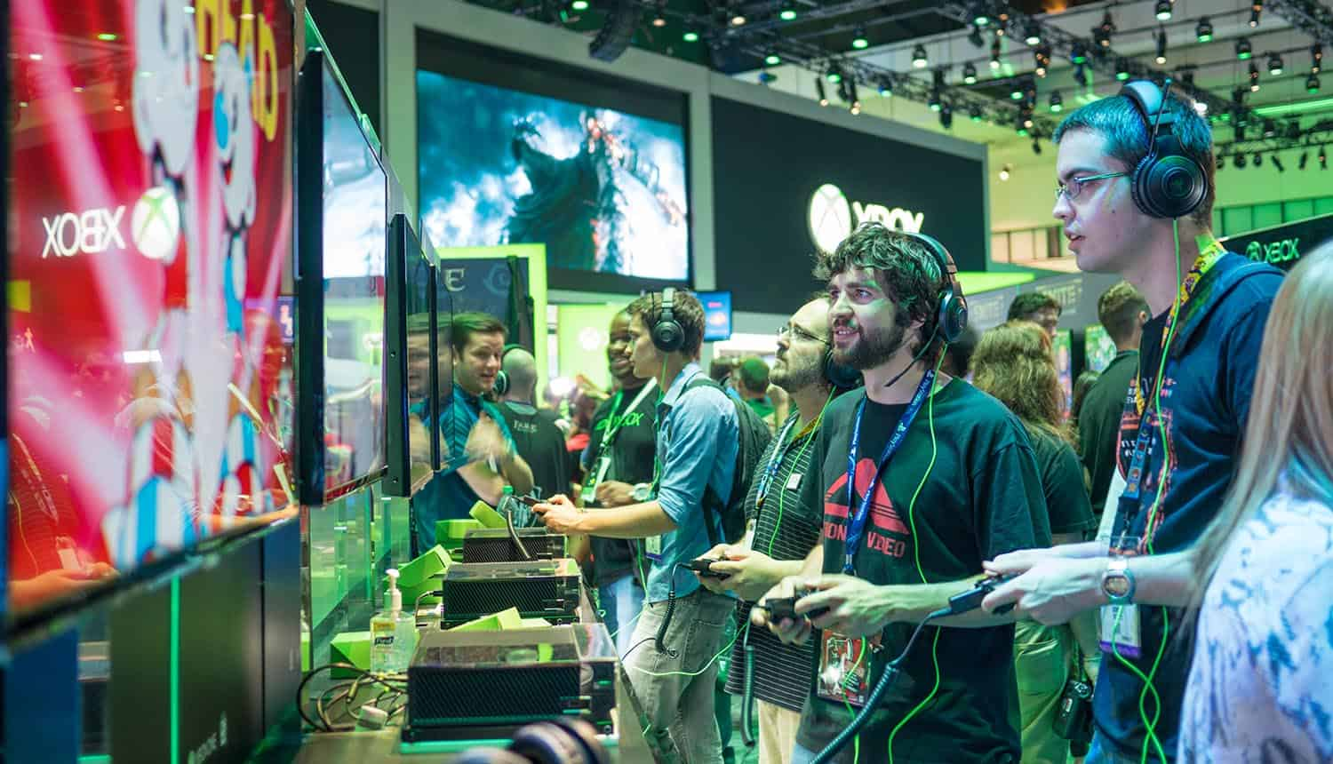 Gamers playing demo games showing need to make cybersecurity a priority in gaming