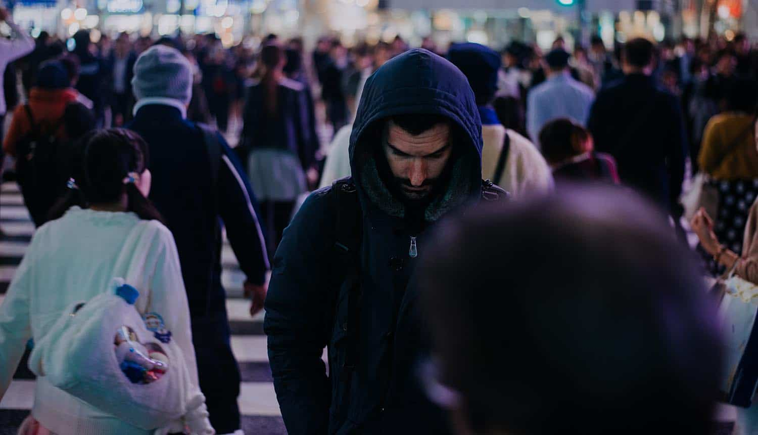 Hacker standing among city crowd showing massive data breach at Bulgaria national tax agency which exposed five million citizens' information