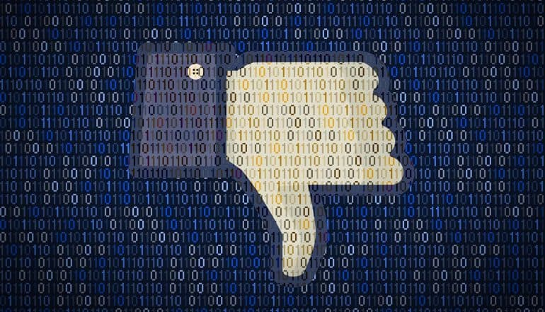 Facebook thumb down logo against binary code showing different responses and views over record-setting $5 billion Facebook fine