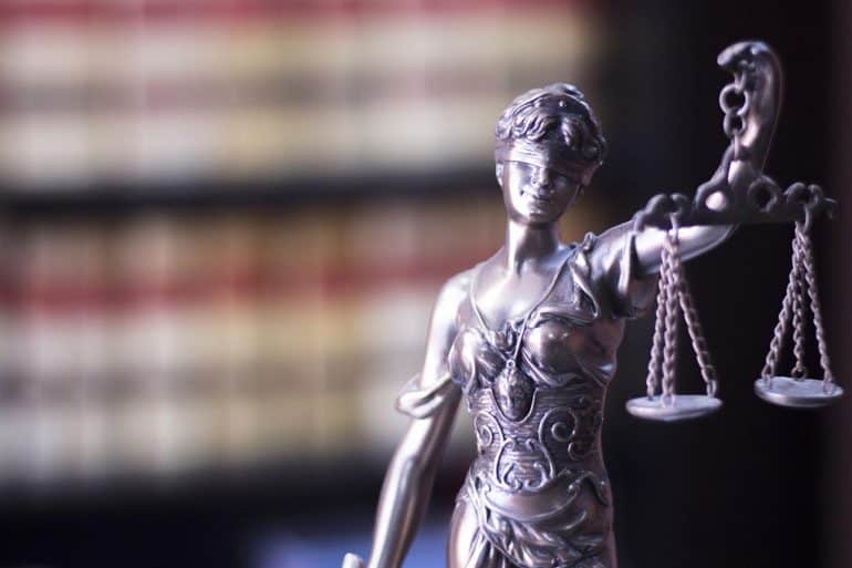 Legal blind justice Themis metal statue showing the future of data privacy in U.S.