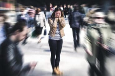 Woman having panic attack on the street showing the privacy concerns over Amazon's new facial recognition capability to read fear on human faces