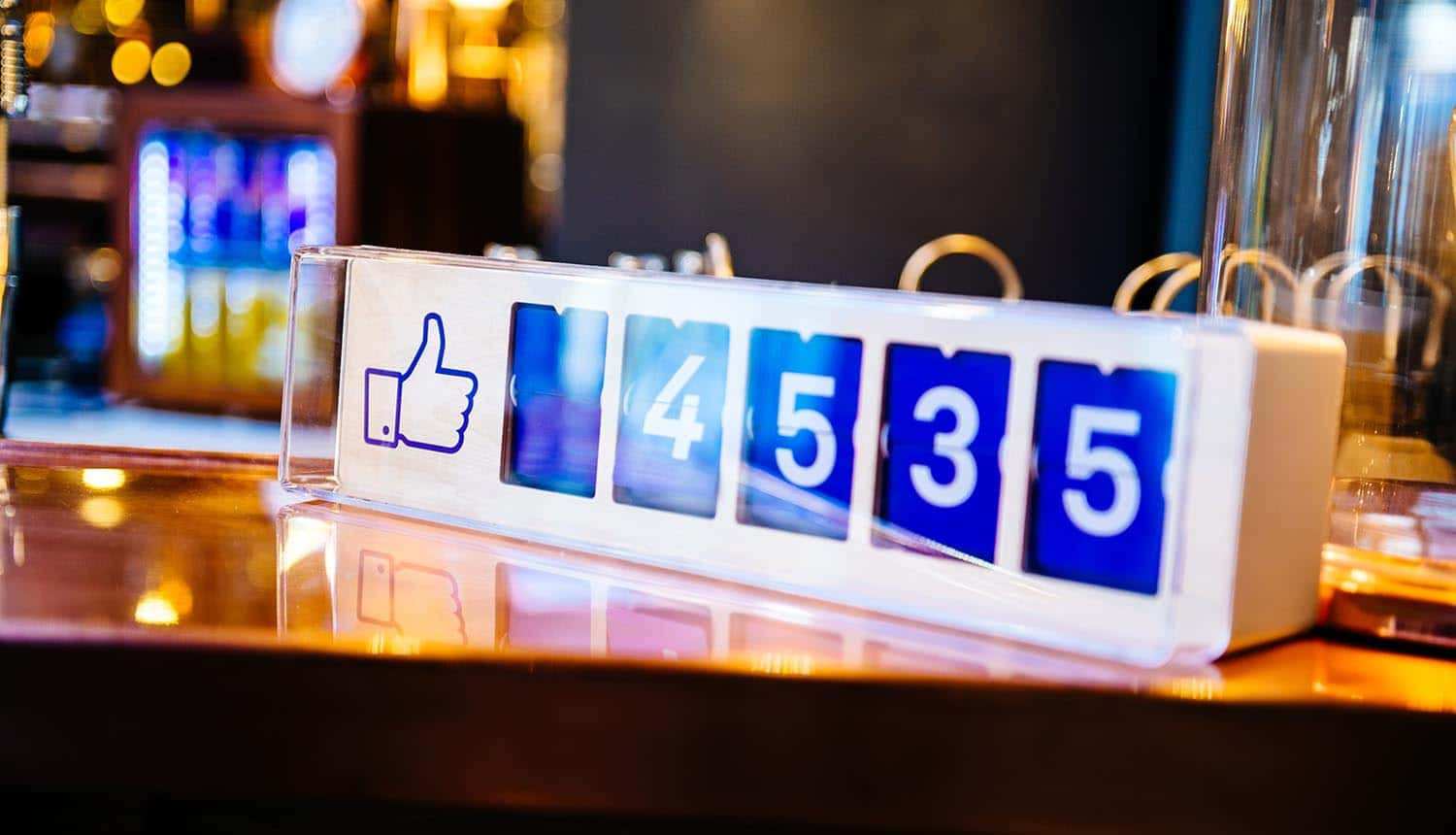 "Facebook ""likes"" device counter on table showing how the recent EU court ruling on Facebook 'like' button could have huge implications for websites"