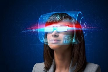 Woman with high tech smart glasses showing how movies can help you understand data privacy and hacking