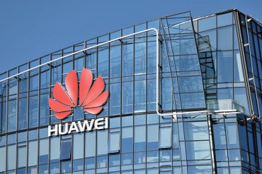 Huawei company building showing new study found Huawei's links to Chinese intelligence and military