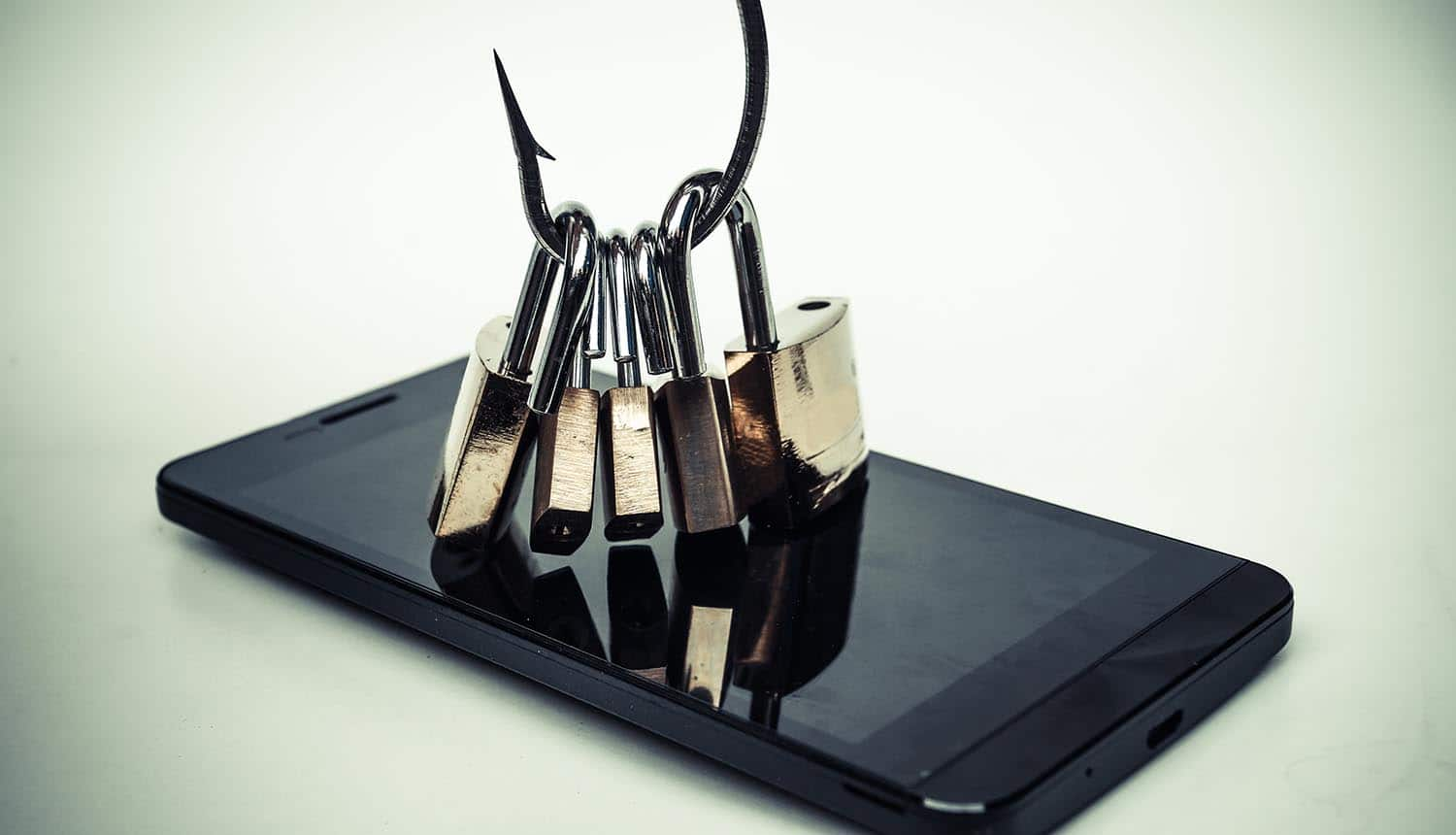 Hook with open locks on mobile phone showing the recent phishing attack on ProtonMail accounts of Bellingcat journalists was linked to Russia
