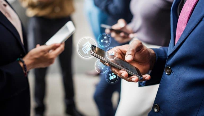 Businessmen using mobile phones showing how Dashboard Act keeps U.S. on the frontlines of data privacy even though NYPA fails to pass legislation