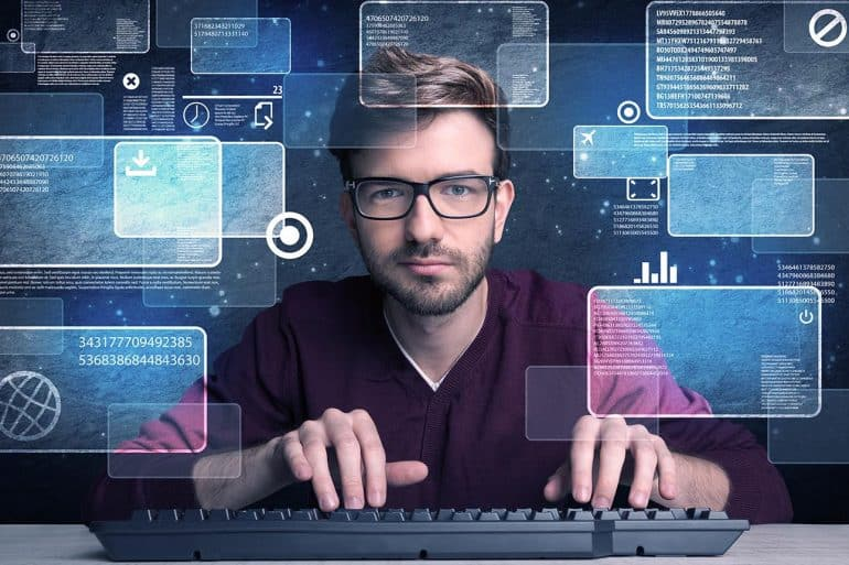 Hacker working on computer showing how company can keep up with ethical hacking