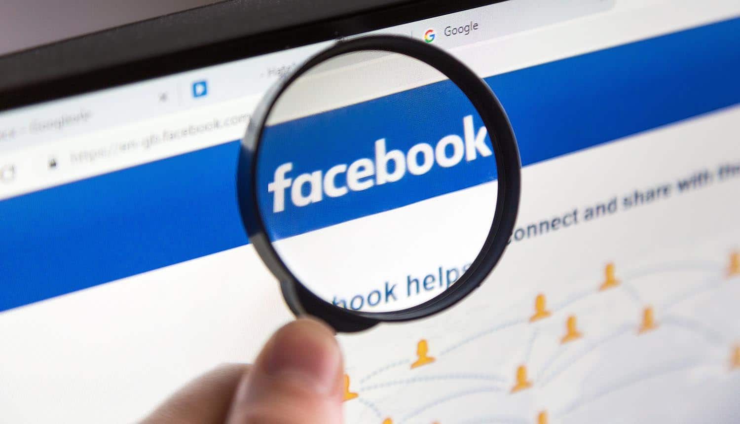 Magnifying glass over Facebook web page showing the massive app suspension from Facebook privacy investigation