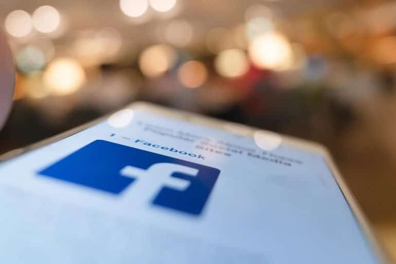 Facebook icon on mobile phone showing new Facebook privacy tool in trial phase which allows user to clear browsing history